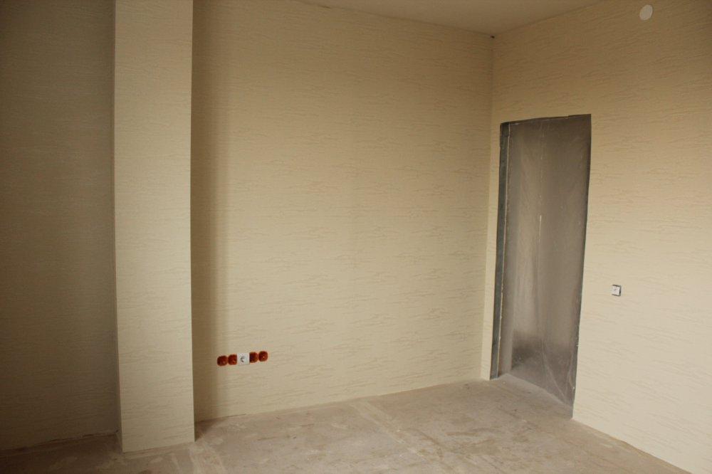 Как декорировать стояк отопления в углу комнаты?